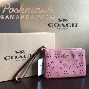 Coach Wristlet in Vintage Pink - Floral Cut Outs